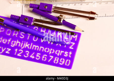 Geometry Box Set with Ruler, Protractor, Mechanical Pencil Compass and Pencil and stencil - Stock Photo