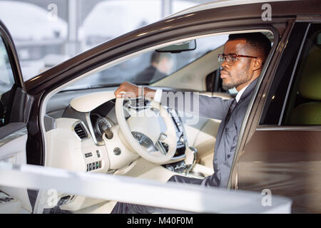 Stylish black man in car - Stock Photo