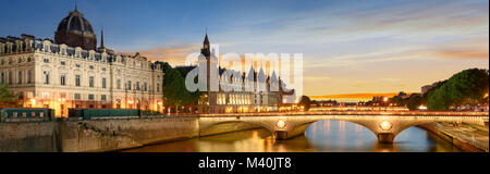 Consiergerie, Pont Neuf and Seine river with tour boat at sunny summer sunset, Paris, France - Stock Photo