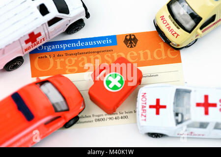 An organ donor card and ambulance, Organspendeausweis und Rettungswagen - Stock Photo