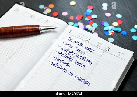 Calendar with good intentions for the new year, Kalender mit guten Vorsätzen für das neue Jahr - Stock Photo