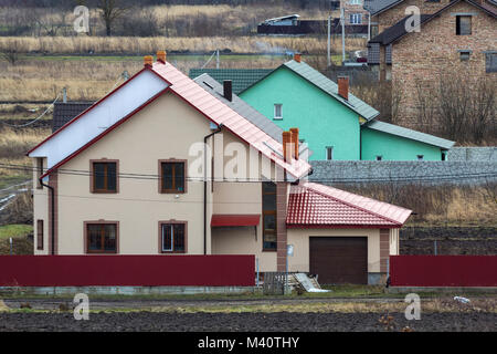 Beautiful exterior of newly built luxury home. Residential house in suburbun area. - Stock Photo
