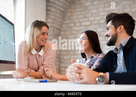 Picture of young architects discussing in office - Stock Photo