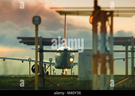 An Easyjet plane lining up on the runway ready for take off with landing lights in the foreground at Liverpool John - Stock Photo