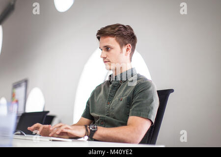 Businessman typing on a keyboard - Stock Photo