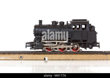 1950s vintage model steam locomotive on the rails - Stock Photo