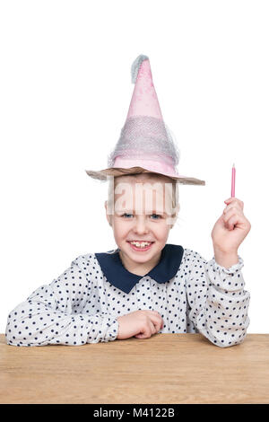 Portrait of a beautiful little girl in a cone hat with a pencil in her hand isolated on a white background - Stock Photo