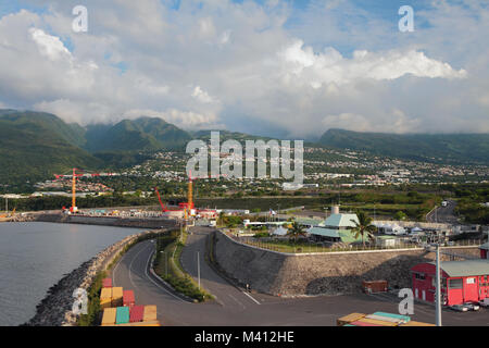 Seaport at foot of mountains. Zone Industrielle ZI, Reunion - Stock Photo