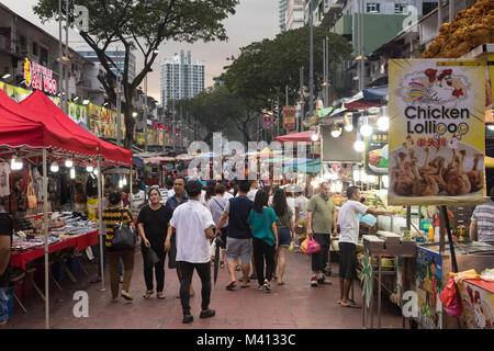 Kuala Lumpur, Malaysia - December 22 2017: Tourists and locals wander along Jalan Alor famous for its chinese food - Stock Photo