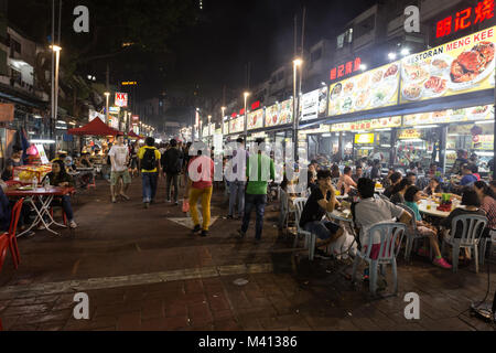 Kuala Lumpur, Malaysia - December 22 2017: Tourists and locals eating in Jalan Alor famous for its chinese food - Stock Photo