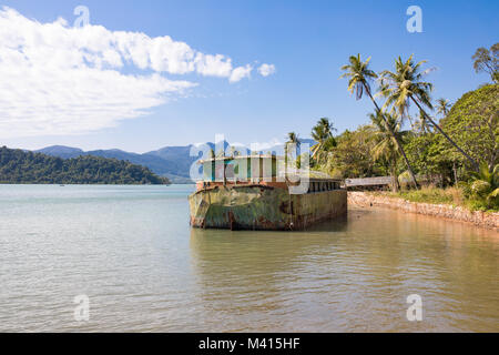Abandoned ship wreck on sea, Southern coast of the island Koh Chang, Thailand - Stock Photo
