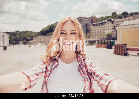 Hello, how is your life? Portrait of excited cheerful joyful beautiful cute lovely woman with toothy smile dressed - Stock Photo