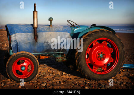 Sea-going tractors wrapped up against the elements in Redcar, Cleveland, England, Britain - Stock Photo