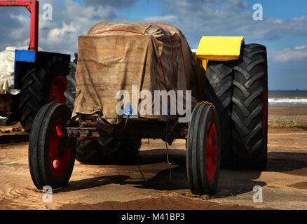 Sea-going tractors wrapped up against the elements in Saltburn-by-the-Sea, Cleveland, England, Britain - Stock Photo