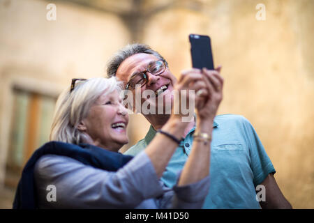 Senior couple on vacation taking a selfie or on video call - Stock Photo