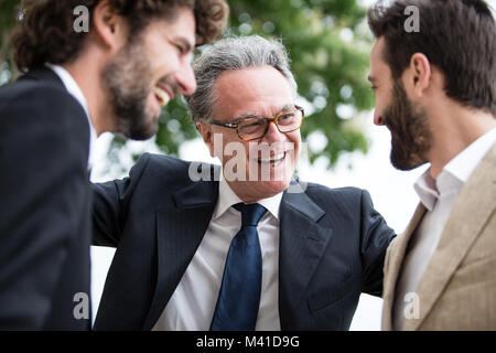 Senior male with his two grown-up sons - Stock Photo
