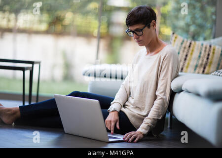 Woman working from home - Stock Photo