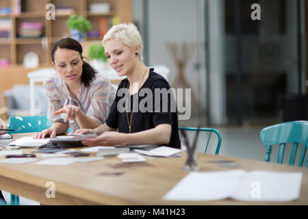 Female designers working on a project - Stock Photo