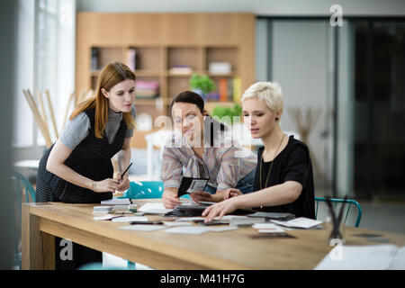 Female coworkers working on a project - Stock Photo