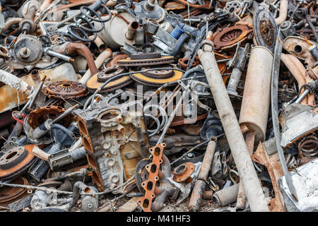 Background pile of rusted metal scrap on the open air. - Stock Photo
