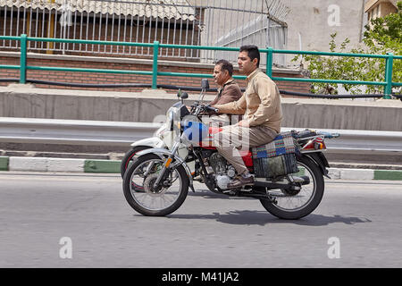 Tehran, Iran - April 28, 2017:  Two motorcyclists without helmets ride along the highway in parallel at high speed. - Stock Photo
