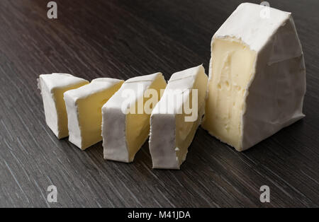 camambert blu cheese on the black background - Stock Photo