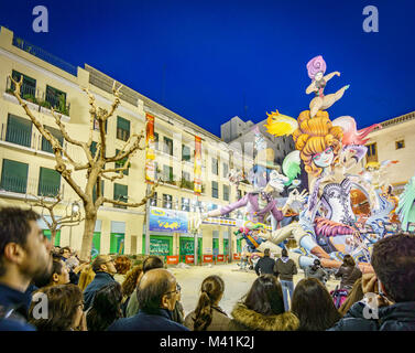 VALENCIA, SPAIN- MARCH 15, 2015: Crowd observe El Pilar Falla in Valencia at dusk, the Fallas is a typical celebration - Stock Photo