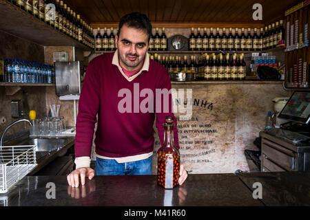 A ginjinha barman in Lisbon, Portugal. - Stock Photo