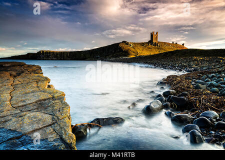 A photograph of Dunstanburgh Castle in Northumberland. - Stock Photo