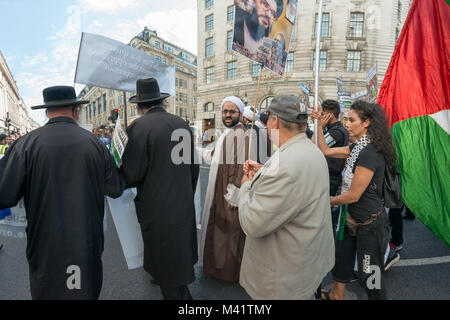 The line of anti-Zionist Neturei Karta Jews and Muslim clerics at the front of the Al Quds Day march was followed - Stock Photo