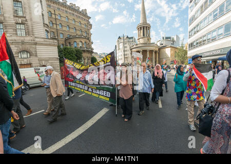 People carry a large banner about the boys from Hares, tortured and caged after invented allegations that they threw - Stock Photo