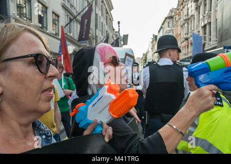 Class War 'Women's Death Squad at work at the protest at Sotheby's in Old Bond St calling for reinstatement of the - Stock Photo