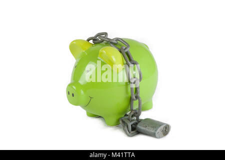 Piggy bank with chain and padlock on a white background. Symbolic of keeping money safe under lock and key.