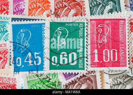 colorful stamped old French stamps - Stock Photo