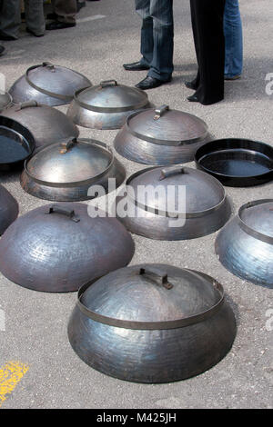 Peka; equipment for traditional cooking on fire place; fair in Split; Croatia - Stock Photo