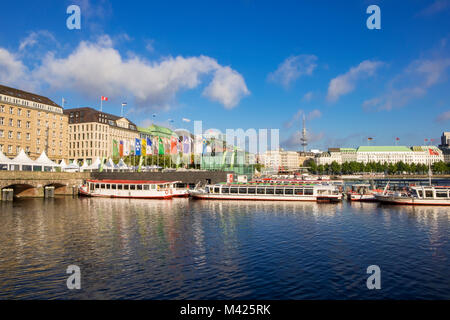 Alster Lake with pleasure cruise boats, in central Hamburg, Germany - Stock Photo