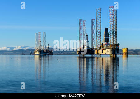Oil rigs / drilling platforms moored in Cromarty Firth viewed from town of Cromarty on the Black Isle in Ross & - Stock Photo