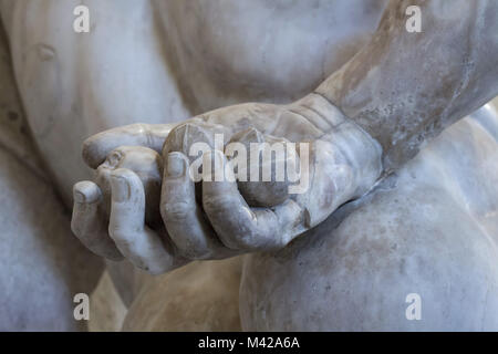 Golden apples from the Garden of the Hesperides. Detail of the Farnese Hercules. Roman marble copy from the end - Stock Photo