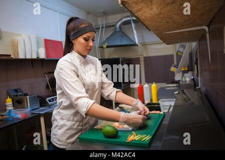 a girl prepares food sushi Bistro nice - Stock Photo
