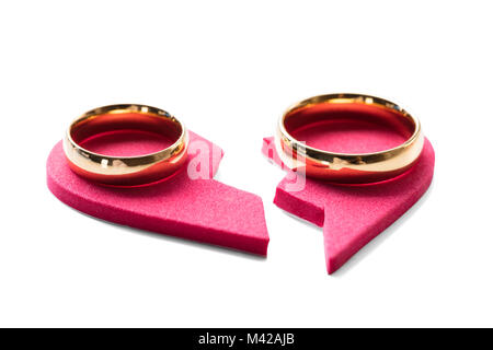 High Angle View Of Golden Ring On Red Broken Heart On White Background - Stock Photo