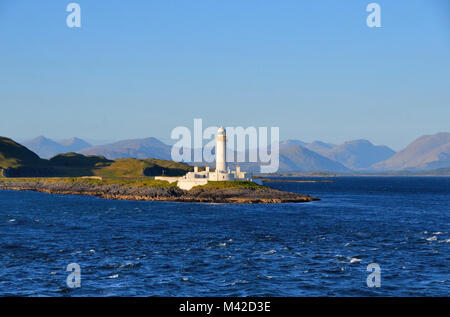 View of Eilean Musdile lighthouse as seen from the ferry between Oban and Iona - Stock Photo
