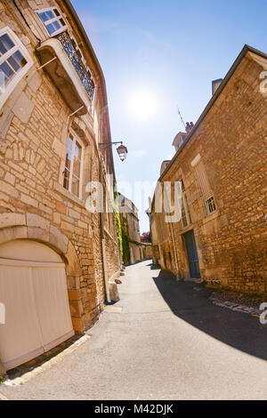 Narrow street of old city in Besancon at sunny day, France - Stock Photo