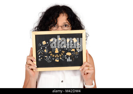 Business woman holding chalkboard with feedback sketch. - Stock Photo