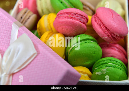 Colorful French or Italian macaron stack on wood table with copy space for background. Macarons or macaroons is - Stock Photo