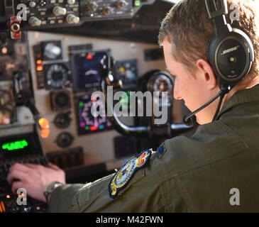 Air Force 1st Lt. Blake Kidd, 351st Air Refueling Squadron pilot puts coordinates into a KC-135 navigation system - Stock Photo