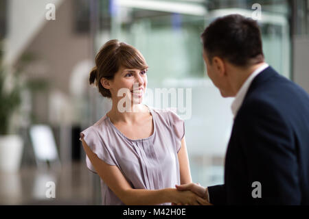 Young female businesswoman being offered a job - Stock Photo