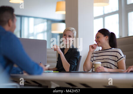 Business colleagues in a morning meeting with coffee - Stock Photo