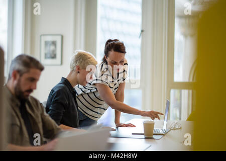 Manager training new employee in office - Stock Photo