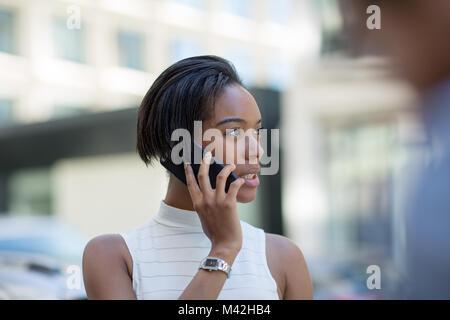 Businesswoman on way to work using smartphone - Stock Photo