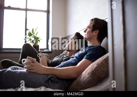Young male couple relaxing with coffee - Stock Photo